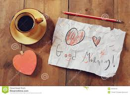 heart shaped writing paper top view image of paper with the text good morning next to coffee top view image of paper with the text good morning next to coffee cup and wooden