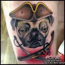 dog hat tattoo by rock n roll tattoo