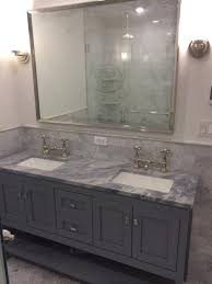 the most help with tight master bath 18 inch or 22 inch depth