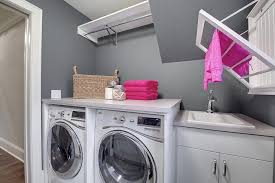 laundry room with over the sink drying rack contemporary