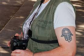 25 striking hamsa tattoo designs slodive