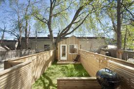tiny backyard studio lets architect keep an eye on his kid curbed