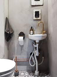 Cement Bathroom Sink - warm up your bathroom with metal fixtures