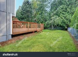 backyard view grey rambler house upper stock photo 718697710