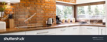 stylish and modern kitchen window modern kitchen corner stylish brick wall stock photo 513248227