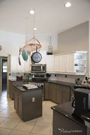 sherwin williams brown kitchen cabinets painting the kitchen cabinets addict