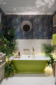 prime bathroom trends set to make a big splash in the seasons wallpaper and plants develop a jungle inspired environment inside the eclectic bathroom style
