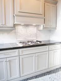 Herringbone Marble Backsplash by Carrara Marble Backsplash With A Herringbone Pattern Slate Tile In