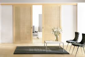 light brown wooden sliding doors with plait patter on the middle