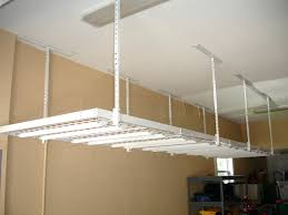 wire grid shelves overhead storage for rarely used items dvd ideas