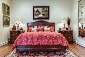 alaskan king bed with traditional bedroom dark wood nightstand