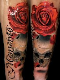 natural colored big red rose tattoo on forearm with corrupted