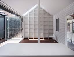 Row House In Sumiyoshi - inventive addition to heritage cottage challenges our idea of a roof