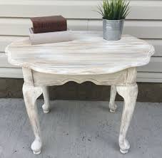 rustic end table painted with layers of annie sloan old ochre