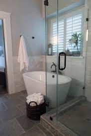 best ideas about small bathroom bathtub pinterest amazing how free standing tub this stunner can make space feel much more spacious add the glass enclosed shower and you got killer