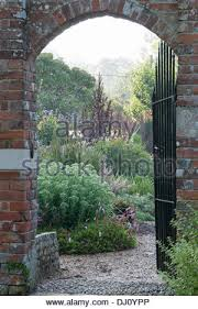 view through a gate to the walled garden adjacent to the cowdray