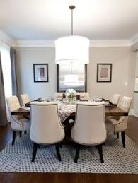 gray square dining table with white dining chairs for the home