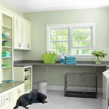 laundry room with tall storage cabinet contemporary laundry room