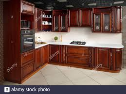 modern kitchen with cherry wood cabinets interior of modern kitchen in classic style with golden