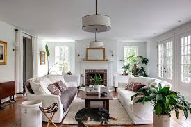 sconces over fireplace living room traditional with brown cushion