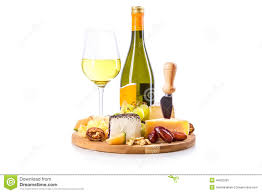 wine bottle cheese plate bottle and glass of white wine with cheese plate stock image