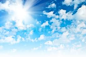 blue sky with sparce cumulus clouds and sun stock photo colourbox