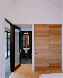 sliding closet door bathroom contemporary with wood closet doors