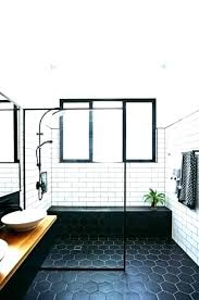subway tiles white white tile dark grout white tile dark grout faucet in the wall o
