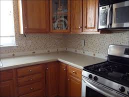 white kitchen backsplash photos black countertop cabinets gray