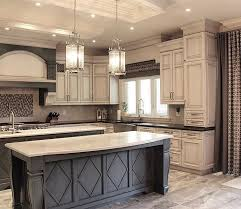 grey kitchen island grey island with white countertop and antique white cabinets