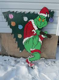grinch stealing outdoor christmas decorations