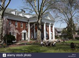 colonial club large red brick house with two story white column