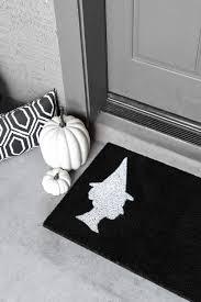 how to make a diy halloween doormat the tomkat studio blog