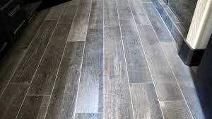 large custom home with porcelain tile and natural stone plank