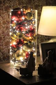 lights and ornaments in a cylinder vase size h 24