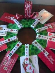 a christmas wreath full of gift cards what a super class gift for