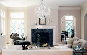 beige fireplace mantels living room traditional with black ottoman