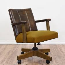 this mid century modern office chair is upholstered in a