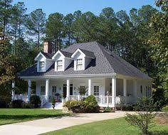 southern home plans with wrap around porches plan 32533wp charming country home plan southern house plans
