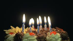 spinning birthday candle 4k blowing out birthday candles on a spinning delicious chocolate