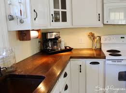 countertops white cabinets bronze handles butcher block white cabinets bronze handles butcher block countertops under cabinet lights