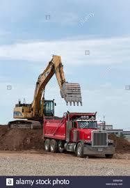 new peterbilt trucks caterpillar excavator loads up a peterbilt dump truck on re use