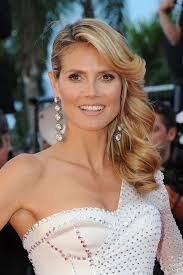 front view of side swept hairstyles a front view of heidi klum s side swept hairstyle with rolls