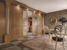 boiserie completely realized in solid wood panels carved details