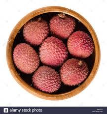 lychee fruit peeled lychee or litchi fruits in wooden bowl unpeeled ripe red litchi