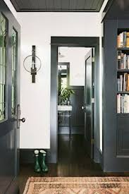 dark trim matches bookcases white walls wood ceiling matches