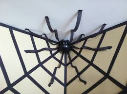 halloween ornaments to make halloween decor giant spider in a web using streamers and a
