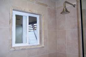 Porcelain Wall Tile With Travertine Detail At Crown And Window - Bathroom window design