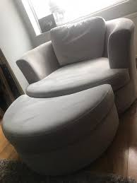 swivel cuddle chair dfs silver grey freya large swivel cuddle chair with half moon