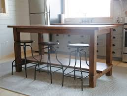 kitchen island tables with stools white farmhouse style kitchen island for alaska lake cabin